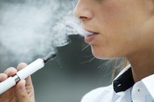 Teen smoking vapor cigarette 300x200 - Tabaco 21